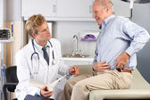 Doctor Examining Male Patient With Hip Pain — Stock Photo