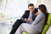 Businesspeople With Digital Tablet Sitting In Modern Office — Stock Photo