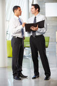 Two Businessmen Having Informal Meeting In Modern Office — Stock Photo