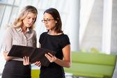 Two Businesswomen Having Informal Meeting In Modern Office — Stock Photo