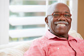 Portrait Of Happy Senior Man At Home — Stock Photo