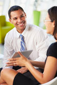 Businesspeople With Digital Tablet Having Meeting InOffice — Stock Photo