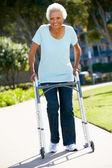 Senior Woman With Walking Frame — Stock Photo