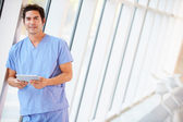 Doctor Using Digital Tablet In Corridor Of Modern Hospital — Stock Photo