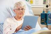Senior Female Patient Relaxing In Hospital Bed With Digital Tabl — Stock Photo