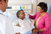 Doctor Talking To Senior Couple On Ward — Stock Photo