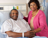 Senior Wife Visiting Husband On Ward — Stock Photo