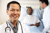 Portrait Of Doctor With Patient In Background — Stock Photo