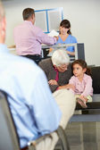 Patients In Doctor's Waiting Room — Foto Stock