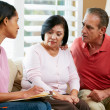 Nurse Making Notes During Home Visit With Senior Couple — Stock Photo #24650405