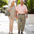 Senior Couple Walking Along Street Together — Stock Photo