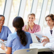 Medical Team Meeting Around Table In Modern Hospital — Stock Photo