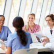 Medical Team Meeting Around Table In Modern Hospital — Stock Photo #24650101