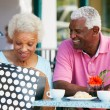 Stock Photo: Senior Couple Enjoying Snack At Outdoor Cafe After Shopping