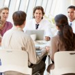 Medical Team Discussing Treatment Options With Patients - Stock Photo