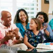 Multi Generation Family Celebrating Daughter's Birthday - Stock Photo