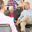 Patients In Doctor&#039;s Waiting Room - Stock Photo