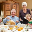 Multi Generation Family Celebrating Thanksgiving - Stock Photo