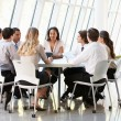 Stock Photo: Business Having Board Meeting In Modern Office