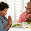 Senior Couple Saying Grace Before Meal At Home — Stock Photo