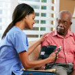 Nurse Visiting Senior Male Patient At Home — Stock Photo