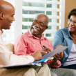 Financial Advisor Talking To Senior Couple At Home — Stock Photo #24651237