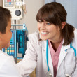 Stock Photo: Doctor Visiting Child Patient On Ward
