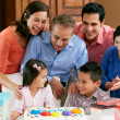 Multi Generation Family Celebrating Children's Birthday - Stock Photo
