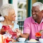 Senior Couple Enjoying Snack At Outdoor Cafe After Shopping — Stock Photo