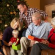 Multi Generation Family Opening Christmas Presents — Stockfoto