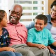 Stock Photo: Grandparents With Grandchildren Sitting On Sofa And Talking