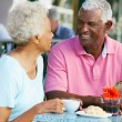 Senior Couple Enjoying Snack At Outdoor Cafe — Stock Photo