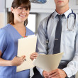 Portrait Of Doctor And Nurse In Doctor's Office — Stock Photo