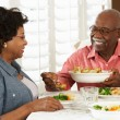 Senior Couple Enjoying Meal At Home — Stock Photo