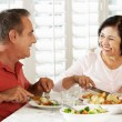 Stock Photo: Senior Couple Enjoying Meal At Home