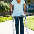 Senior Woman With Walking Frame - Stock Photo