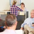 Stock Photo: Patients In Doctor's Waiting Room