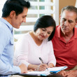Financial Advisor Talking To Senior Couple At Home — Stock Photo #24653491