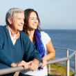 Senior Man With Adult Daughter Looking Over Railing At Sea — Stock Photo