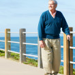 Senior Man Walking Along Path By The Sea — Stock Photo