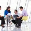 Businesspeople Having Meeting In Modern Office — Stock Photo #24653853