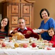 Multi Generation Family Celebrating With Christmas Meal — Stock Photo #24653941