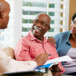 Financial Advisor Talking To Senior Couple At Home — Stock Photo #24654005