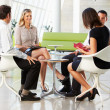 Four Businesspeople Having Meeting In Modern Office — Stock Photo