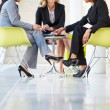 Three Businesswomen Meeting Around Table In Modern Office — Stock Photo #24654163
