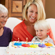 Stock Photo: Family Celebrating Children's Birthday With Grandmother