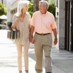 Senior Couple Walking Along Street Together — Stock Photo