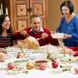 Multi Generation Family Celebrating With Christmas Meal — Stock Photo #24654703