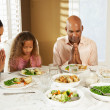 Family Saying Grace Before Meal At Home — Foto Stock #24654783
