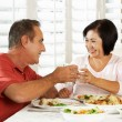 Senior Couple Enjoying Meal At Home — Stock Photo #24654785